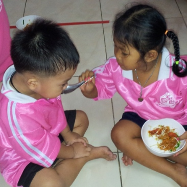 blessing-home-children-feeding-each-other